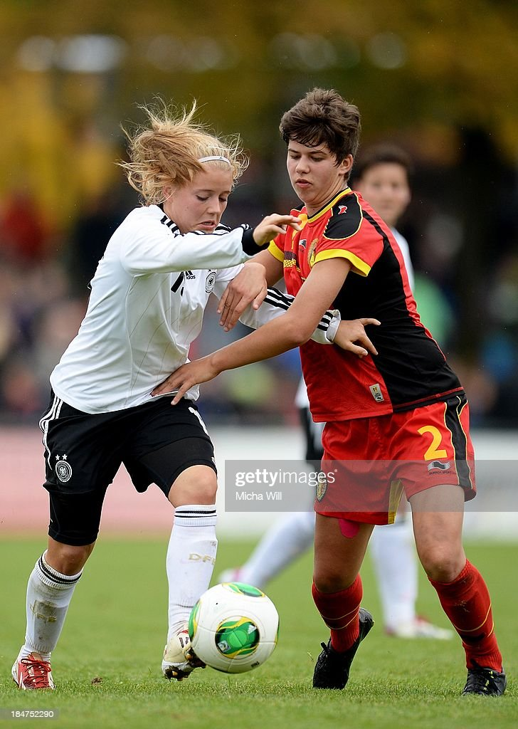 Ricarda Walkling (L) of Germany and Isabelle Iliano of Belgium compete for the ball during the U17 Girls Euro Qualifier match between Germany and Belgium at Bioenergie-Arena on October 16, 2013 in Grossbardorf, Germany.