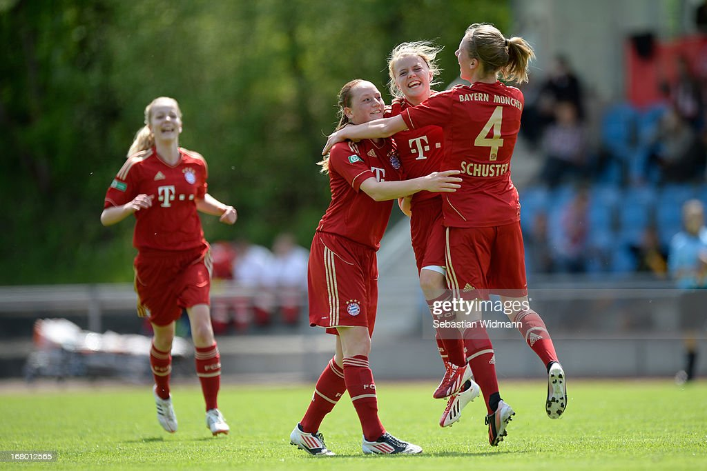 Ricarda Walkling of Muenchen celebrates the opening goal with team mates Jenny Gaugigl (left) and Kristina Schuster during the B Junior Girls match between Bayern Muenchen and VfL Sindelfingen at Sportpark Aschheim on May 4, 2013 in Aschheim, Germany.