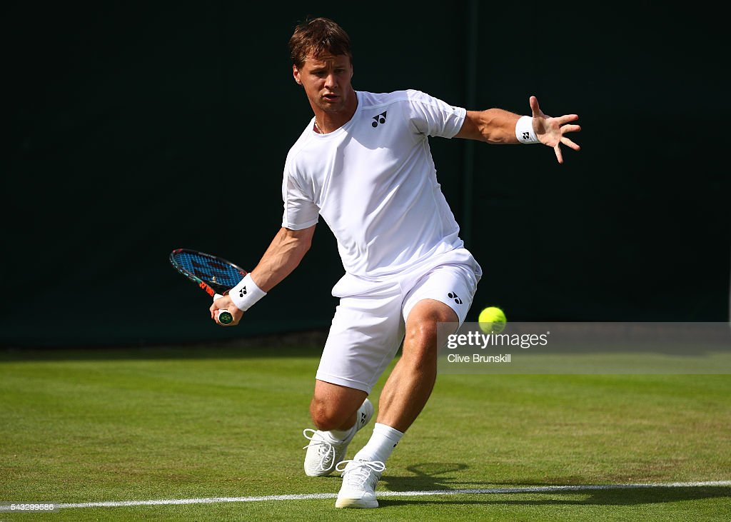 <a gi-track='captionPersonalityLinkClicked' href=/galleries/search?phrase=Ricardas+Berankis&family=editorial&specificpeople=4115400 ng-click='$event.stopPropagation()'>Ricardas Berankis</a> of Lithuainia plays a forehand shot during the Men's Singles first round match against Marcus Willis of Great Britain on day one of the Wimbledon Lawn Tennis Championships at the All England Lawn Tennis and Croquet Club on June 27th, 2016 in London, England.