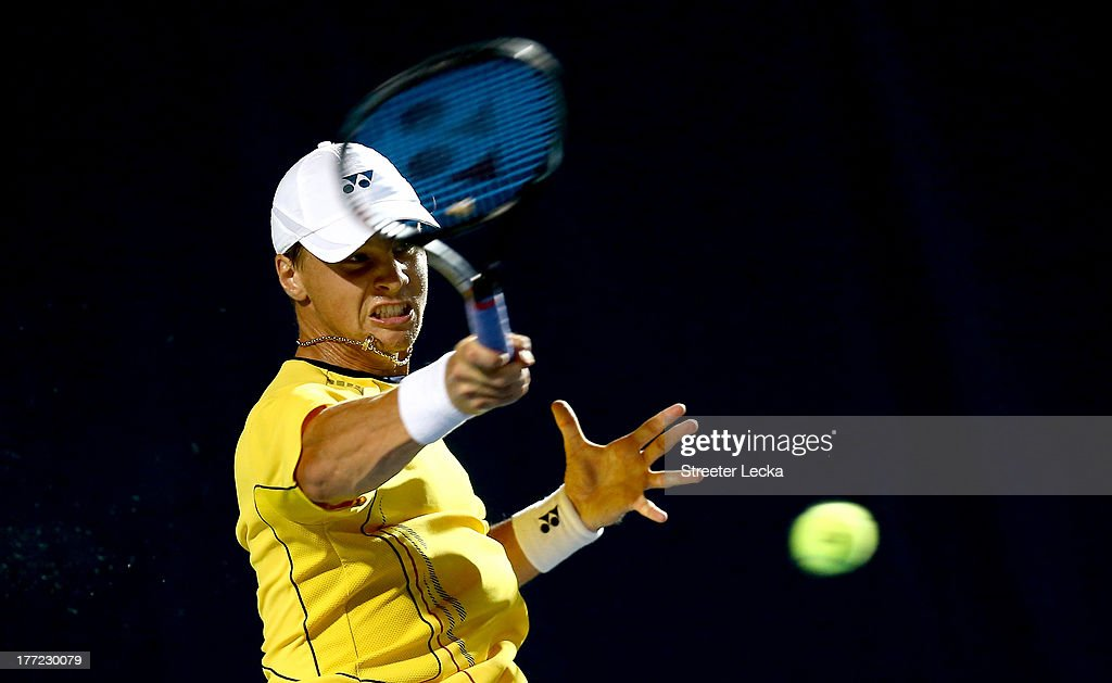 <a gi-track='captionPersonalityLinkClicked' href=/galleries/search?phrase=Ricardas+Berankis&family=editorial&specificpeople=4115400 ng-click='$event.stopPropagation()'>Ricardas Berankis</a> of Lithuania returns a shot to Sam Querrey of the USA in the quarterfinals match during day 5 of the Winston-Salem Open at Wake Forest University on August 22, 2013 in Winston Salem, North Carolina.
