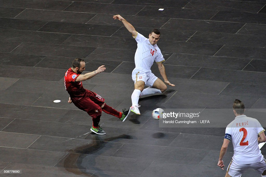 Ricardinho of Portugal, Slobodan Rajcevic and Marko Peric of Serbia in action during the UEFA Futsal EURO 2016 match between Portugal and Serbia at Arena Belgrade on February 6, 2016 in Belgrade, Serbia.