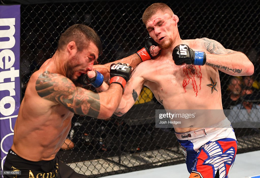 Ricardo Abreu exchanges punches with Jake Collier in their middleweight bout during the UFC event at the Smoothie King Center on June 6 2015 in New...