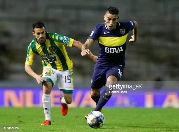Ricardo Adrian Centurion of Boca Juniors fights for the ball with Luis Sosa Otermin of Aldosivi during a match between Aldosivi and Boca Juniors as...