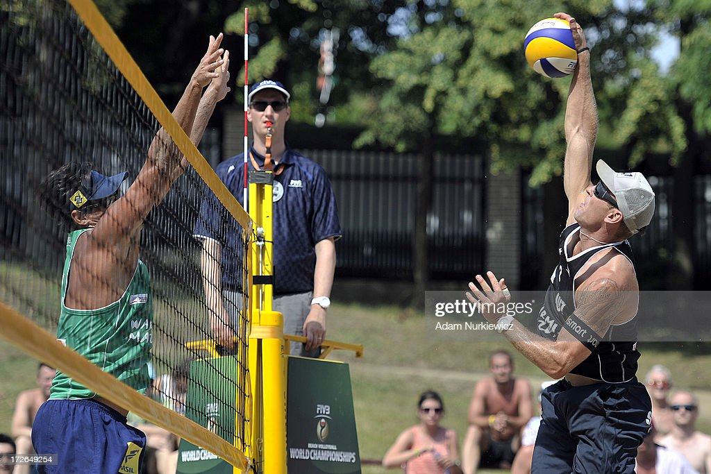<a gi-track='captionPersonalityLinkClicked' href=/galleries/search?phrase=Ricardo+Alex+Costa+Santos+-+Beach+Volleyball+Player&family=editorial&specificpeople=2341965 ng-click='$event.stopPropagation()'>Ricardo Alex Costa Santos</a> (L) of Brazil blocks against <a gi-track='captionPersonalityLinkClicked' href=/galleries/search?phrase=Alexander+Horst&family=editorial&specificpeople=5485598 ng-click='$event.stopPropagation()'>Alexander Horst</a> (R) of Austria during the match between Brazil and Austria during Day 4 of the FIVB World Championships on July 4, 2013 in Stare Jablonki, Poland.