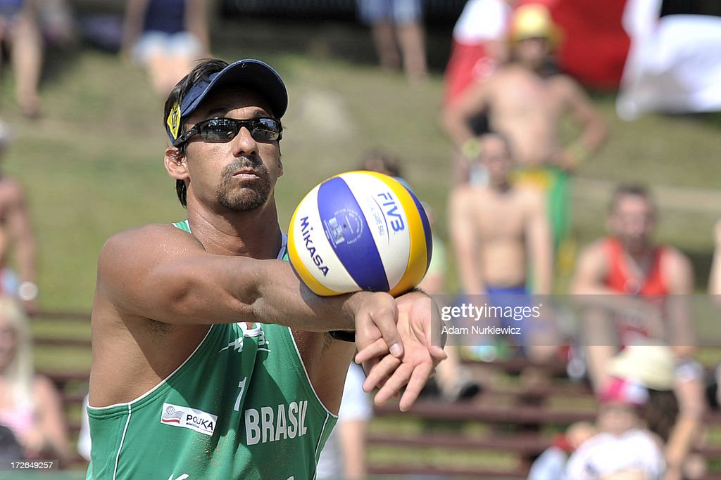 <a gi-track='captionPersonalityLinkClicked' href=/galleries/search?phrase=Ricardo+Alex+Costa+Santos+-+Beach+Volleyball+Player&family=editorial&specificpeople=2341965 ng-click='$event.stopPropagation()'>Ricardo Alex Costa Santos</a> of Brazil passes the ball during the match between Brazil and Austria during Day 4 of the FIVB World Championships on July 4, 2013 in Stare Jablonki, Poland.