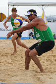 Ricardo Alex Costa Santos of Brazil receives the ball during their main draw match against Philip Dalhausser and Sean Rosenthal of USA on July 23...