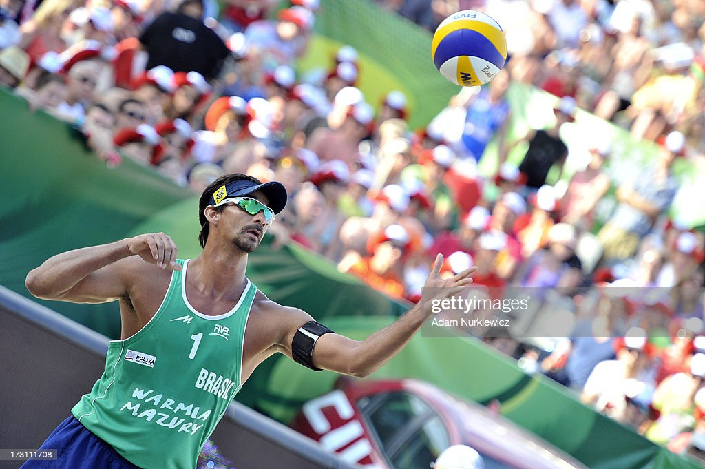 <a gi-track='captionPersonalityLinkClicked' href=/galleries/search?phrase=Ricardo+Alex+Costa+Santos+-+Beach+Volleyball+Player&family=editorial&specificpeople=2341965 ng-click='$event.stopPropagation()'>Ricardo Alex Costa Santos</a> of Brazil serves during the men's final match between the Netherlands and Brazil during Day 7 of the FIVB World Championships on July 7, 2013 in Stare Jablonki, Poland.