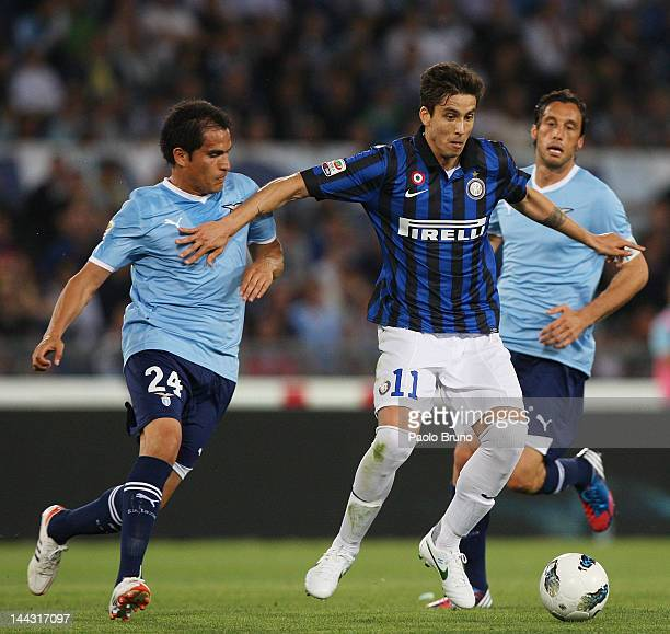 Ricardo Alvarez of FC Internazionale competes for the ball the ball with Cristian Leesma and Stefano Mauri of SS Lazio during the Serie A match...