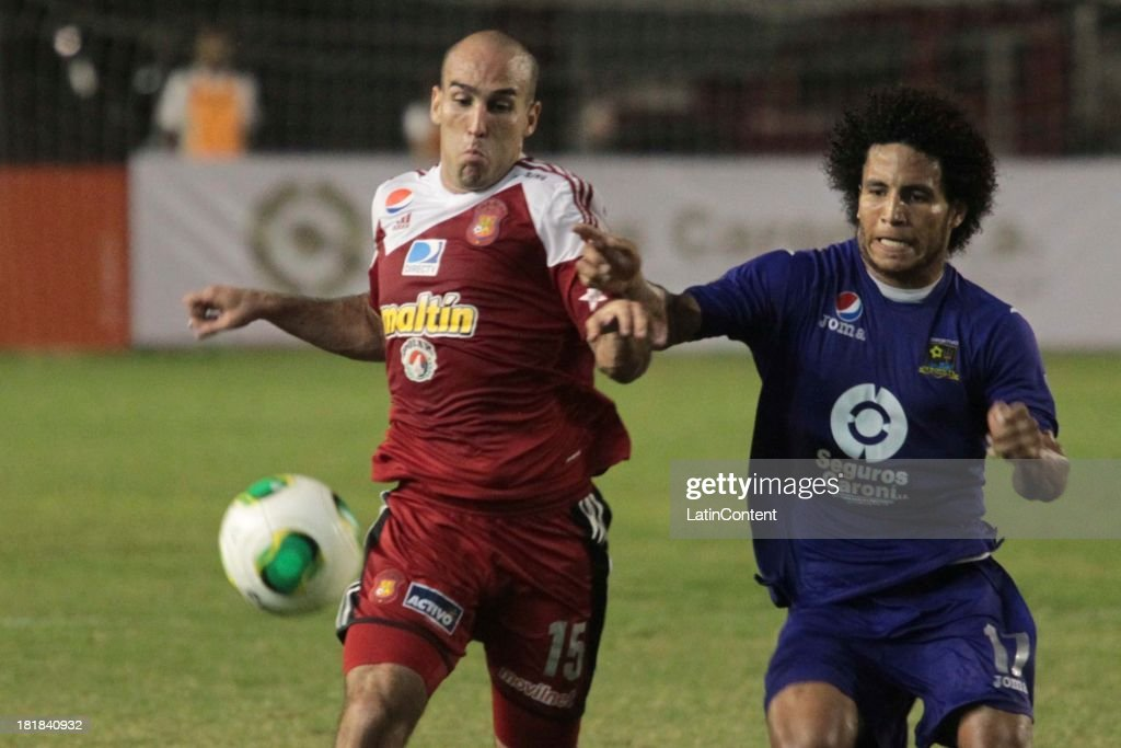 Ricardo Andreutti of Caracas FC competes for the ball during a match between Caracas FC and Deportivo La Guaira as part of the Apertura 2013 at Brígido Iriarte Stadium on September 25, 2013 in Caracas, Venezuela.