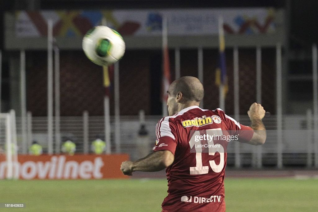 Ricardo Andreutti of Caracas FC heads the ball during a match between Caracas FC and Deportivo La Guaira as part of the Apertura 2013 at Brígido Iriarte Stadium on September 25, 2013 in Caracas, Venezuela.