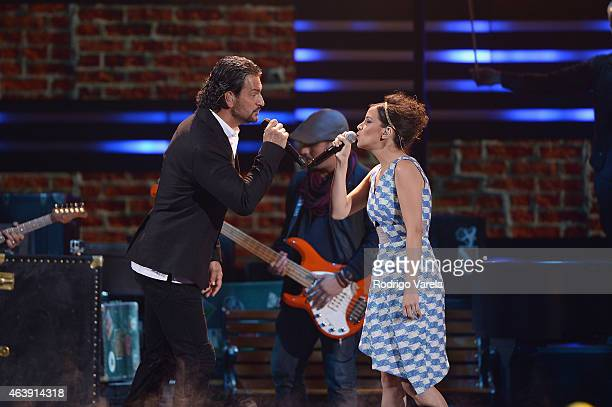 Ricardo Arjona and Gaby Moreno perform onstage at the 2015 Premios Lo Nuestros Awards at American Airlines Arena on February 19 2015 in Miami Florida