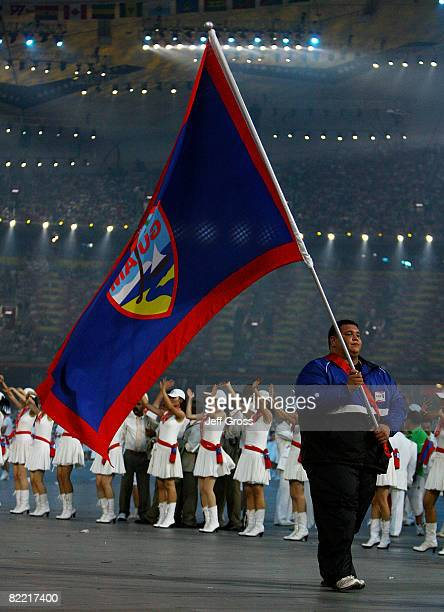 Ricardo Blas of Guam carries his country's flag during the Opening Ceremony for the 2008 Beijing Summer Olympics at the National Stadium on August 8...