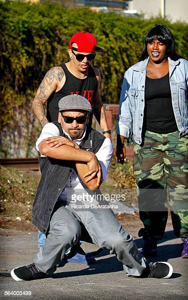 LOS ANGELES CA DECEMBER 10 2012 Ricardo 'Boogie Frantick' Rodriguez Jr showing his moves to fellow members of The Underground Dance Company a Krump...