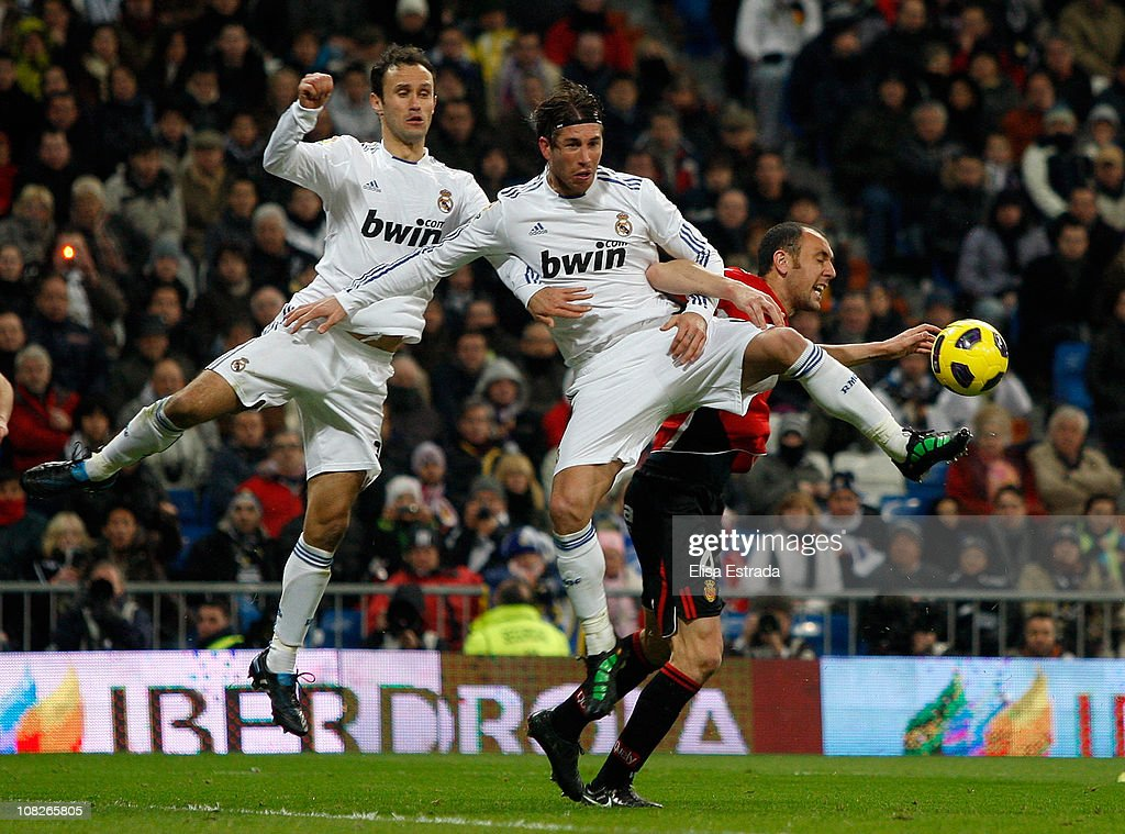 Ricardo Carvalho and Sergio Ramos of Real Madrid fight for a high ball with Ivan Ramis of Mallorca during the La Liga match between Real Madrid and...