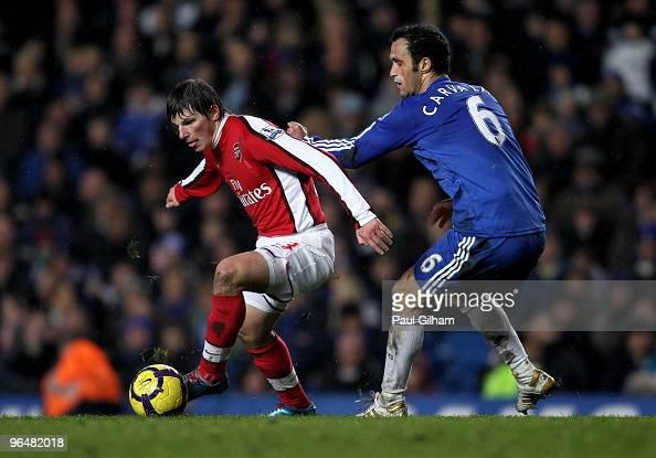 Ricardo Carvalho of Chelsea is beaten by Andrei Arshavin of Arsenal during the Barclays Premier League match between Chelsea and Arsenal at Stamford...