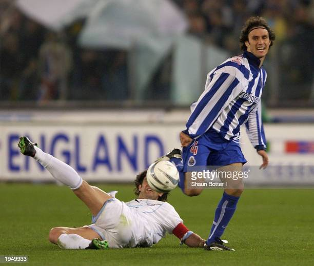 Ricardo Carvalho of Porto avoids a challenge from Couto of Lazio during the Lazio v Porto semi final 2nd leg UEFA Cup match on April 24 2003 at the...