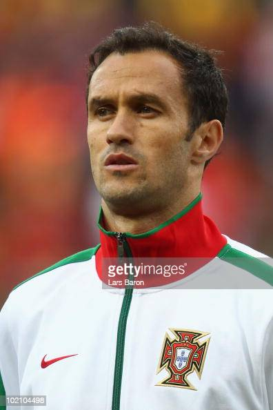 Ricardo Carvalho of Portugal lines up for the national anthems prior to the 2010 FIFA World Cup South Africa Group G match between Ivory Coast and...