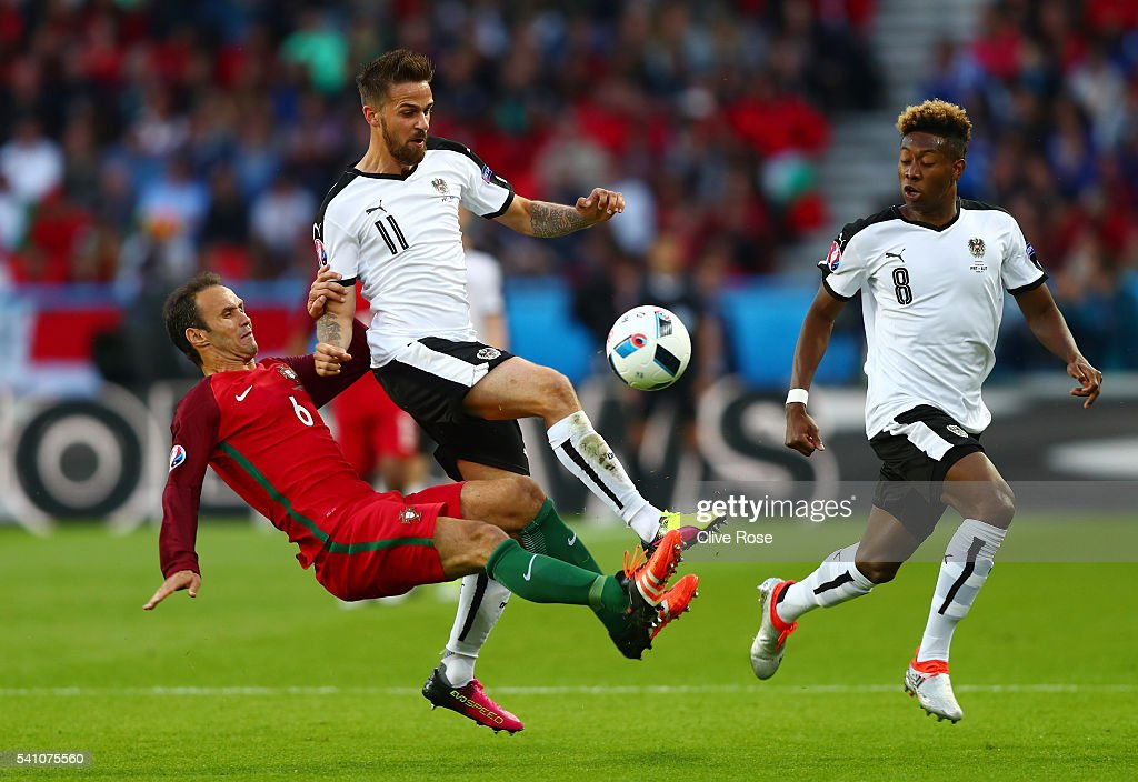 Ricardo Carvalho of Portugal tackles Martin Harnik of Austria during the UEFA EURO 2016 Group F match between Portugal and Austria at Parc des Princes on June 18, 2016 in Paris, France.