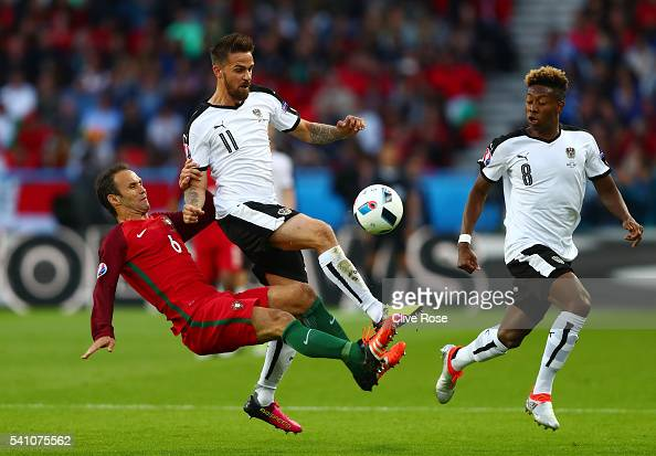 Ricardo Carvalho of Portugal tackles Martin Harnik of Austria during the UEFA EURO 2016 Group F match between Portugal and Austria at Parc des...