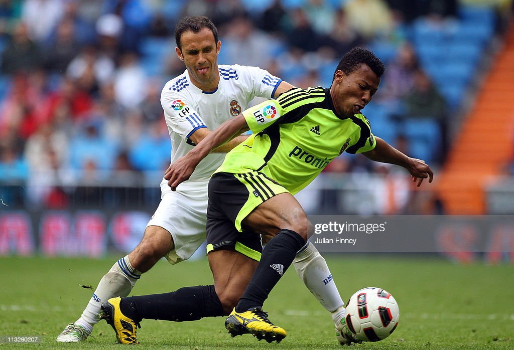 Ricardo Carvalho of Real Madrid battles with Uche of Real Zaragoza during the La Liga match between Real Madrid and Real Zaragoza at Estadio Santiago...