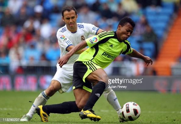 Ricardo Carvalho of Real Madrid battles with Uche of Real Zaragoza during the La Liga match between Real Madrid and Real Zaragoza at Estadio Santiago...