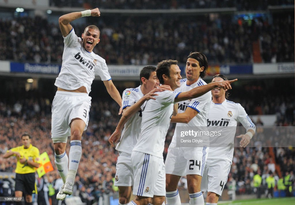 Ricardo Carvalho of Real Madrid celebrates with Pepe and Sami Khedira after scoring his team's first goal during the La Liga match between Real...