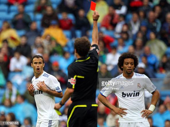 Ricardo Carvalho of Real Madrid is sent off by referee Miguel Angel Ayza Gamez during the La Liga match between Real Madrid and Real Zaragoza at...