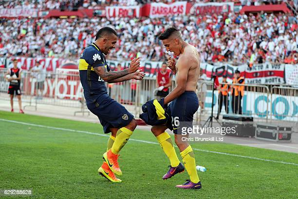 Ricardo Centurion of Boca Juniors celebrates scoring his sides fourth goal with teammate Carlos Tevez during the Argentine Primera Division match...