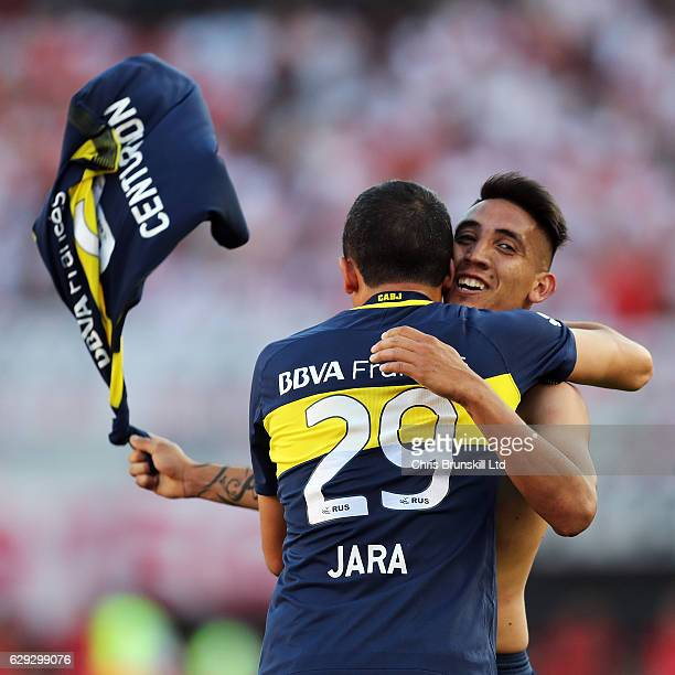 Ricardo Centurion of Boca Juniors celebrates scoring his sides fourth goal with teammate Leonardo Jara during the Argentine Primera Division match...