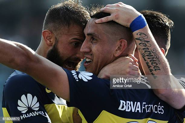 Ricardo Centurion of Boca Juniors celebrates with teammates after scoring the opening goal during a match between Boca Juniors and Sarmiento as part...