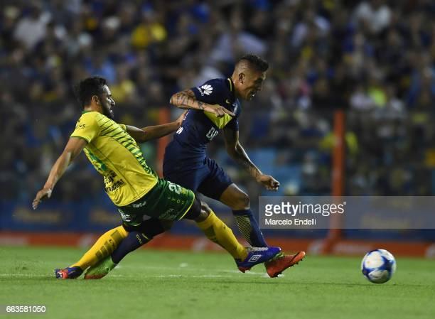 Ricardo Centurion of Boca Juniors drives the ball against Jonas Gutierrez of Defensa y Justicia during a match between Boca Juniors and Defensa y...