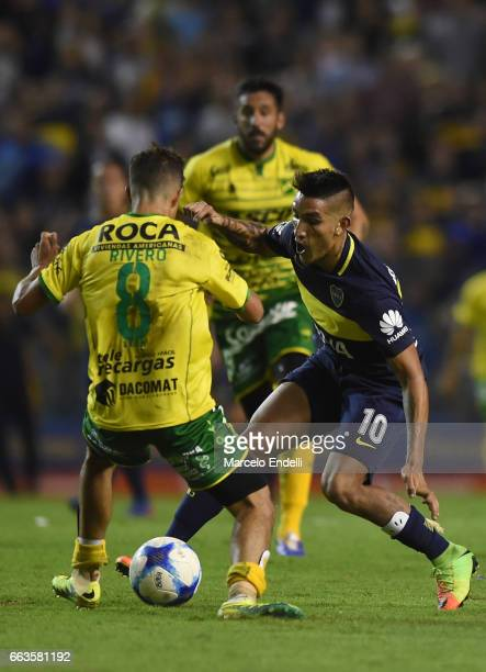 Ricardo Centurion of Boca Juniors fights for the ball with Jose Ignacio Rivero of Defensa y Justicia during a match between Boca Juniors and Defensa...