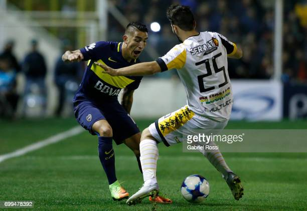 Ricardo Centurion of Boca Juniors fights for the ball with Nicolas Pantaleone of Olimpo during a match between Olimpo and Boca Juniors as part of...