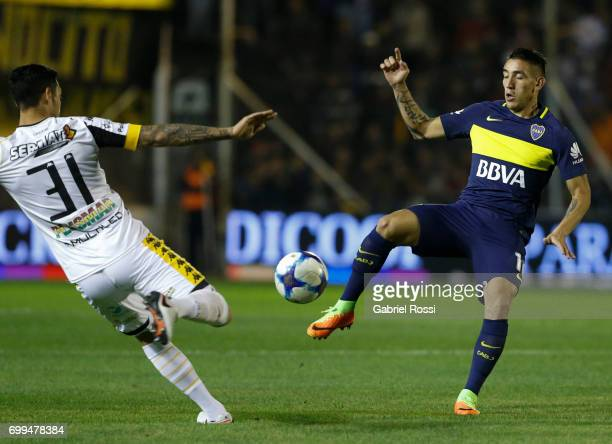 Ricardo Centurion of Boca Juniors fights for the ball with Yonathan Cabral of Olimpo during a match between Olimpo and Boca Juniors as part of Torneo...