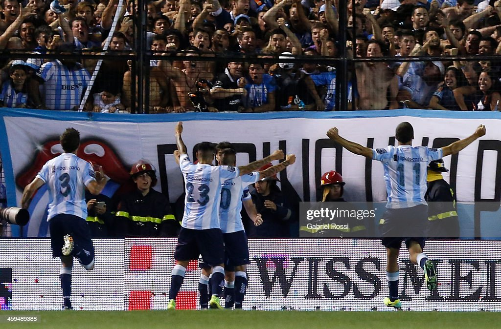 Ricardo Centurion of Racing Club and teammates celebrate the own goal converted by Ramiro Funes Mori of River Plate during a match between Racing Club and River Plate as part of 17th round of Torneo de Transicion 2014 at Presidente Peron Stadium on November 23, 2014 in Buenos Aires, Argentina.