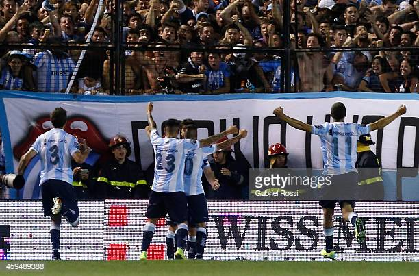 Ricardo Centurion of Racing Club and teammates celebrate the own goal converted by Ramiro Funes Mori of River Plate during a match between Racing...