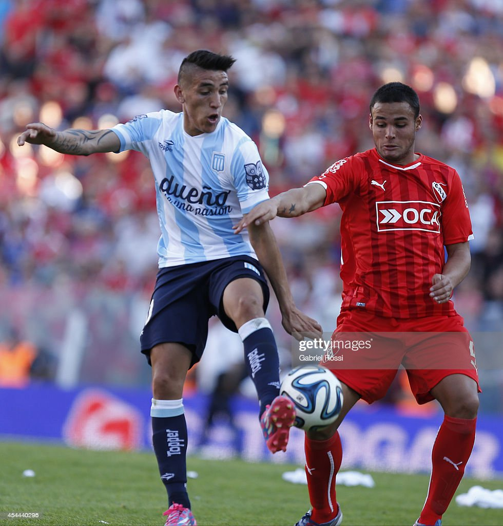 Ricardo Centurion of Racing Club (R) fights for the ball with Nestor Breitenbruch of Independiente (L) during a match between Independiente and Racing as part of fifth round of Torneo de Transicion 2014 at Libertadores de America Stadium on August 31, 2014 in Buenos Aires, Argentina.