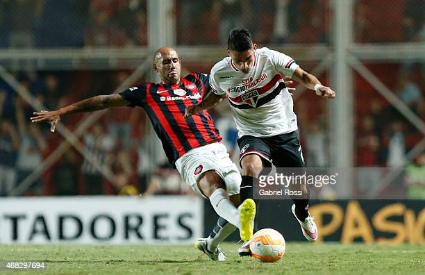 Ricardo Centurion of Sao Paulo fights for the ball with Juan Mercier of San Lorenzo during a match between San Lorenzo and Sao Paulo as part of Copa...