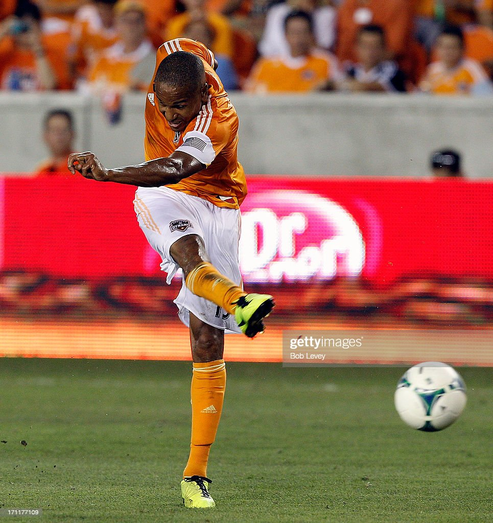 Ricardo Clark #13 of Houston Dynamo puts a shot on goal in the second half against the Toronto FC at BBVA Compass Stadium on June 22, 2013 in Houston, Texas.