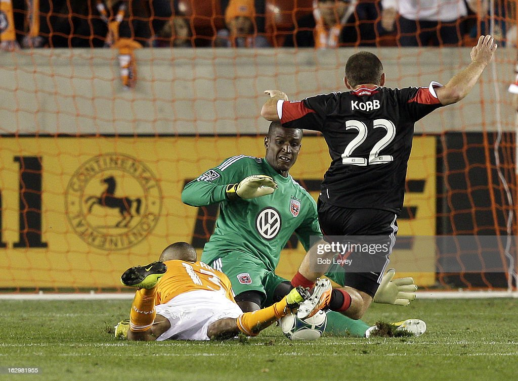 Ricardo Clark #13 of the Houston Dynamo is brought down by Chris Korb #22 of the D.C. United in front Bill Hamid #28 of the D.C. United during first half action at BBVA Compass Stadium on March 2, 2013 in Houston, Texas. A penalty kick was issued on the play.