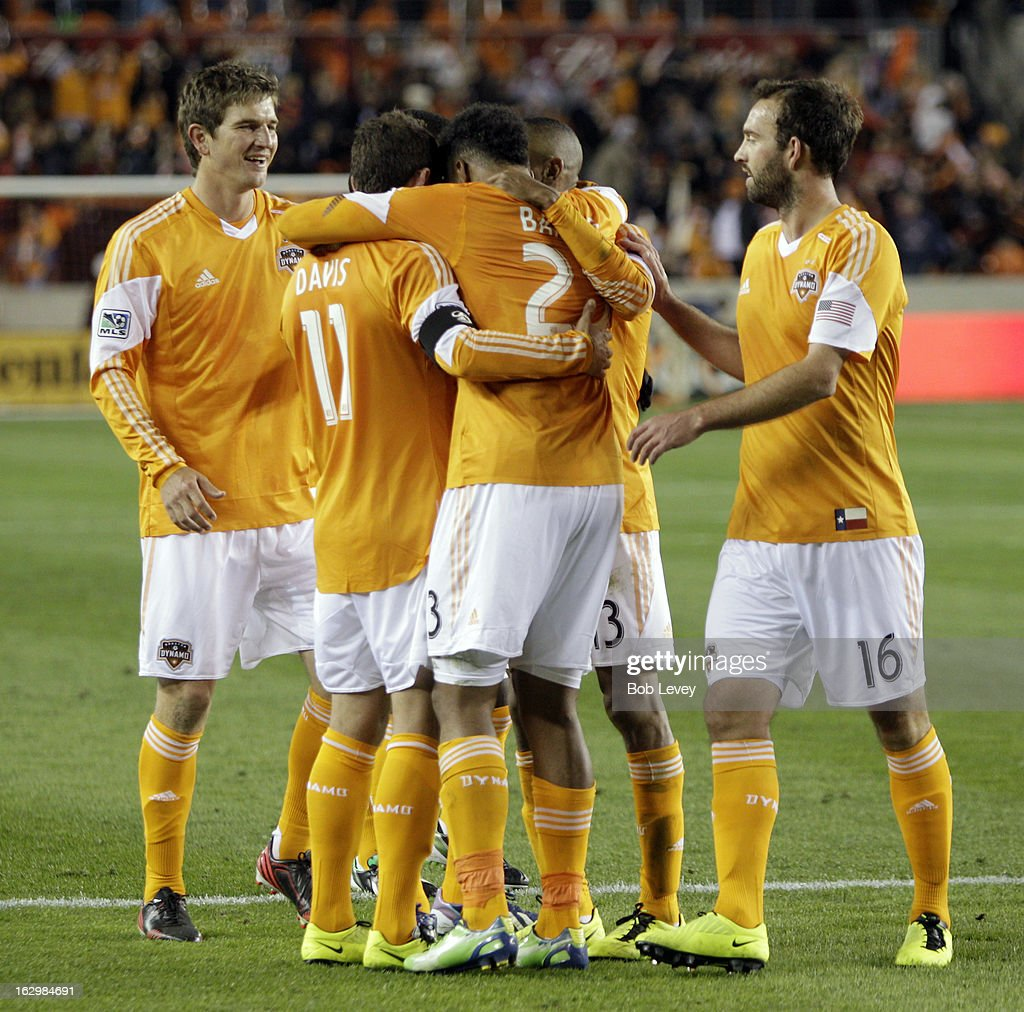 <a gi-track='captionPersonalityLinkClicked' href=/galleries/search?phrase=Ricardo+Clark&family=editorial&specificpeople=2196089 ng-click='$event.stopPropagation()'>Ricardo Clark</a> #13 of the Houston Dynamo is congratulated by Brad Davis #11,Adam Moffat #16, GIles Barnes #23 and <a gi-track='captionPersonalityLinkClicked' href=/galleries/search?phrase=Bobby+Boswell+-+Soccer+Player&family=editorial&specificpeople=587535 ng-click='$event.stopPropagation()'>Bobby Boswell</a> after scoring against D.C. United during second half action at BBVA Compass Stadium on March 2, 2013 in Houston, Texas. Houston won 2-0.