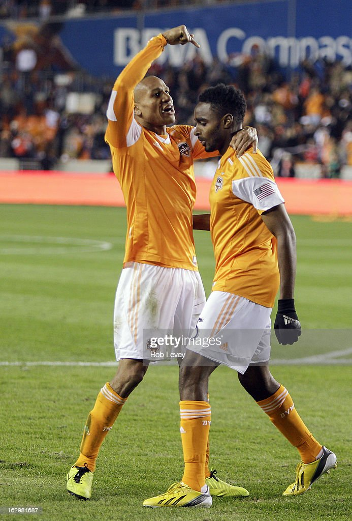 <a gi-track='captionPersonalityLinkClicked' href=/galleries/search?phrase=Ricardo+Clark&family=editorial&specificpeople=2196089 ng-click='$event.stopPropagation()'>Ricardo Clark</a> #13 of the Houston Dynamo points to Warren Creavalle #5 of the Houston Dynamo after his pass enabled him to score his second goal of the game during second half action at BBVA Compass Stadium on March 2, 2013 in Houston, Texas. Houston won 2-0.