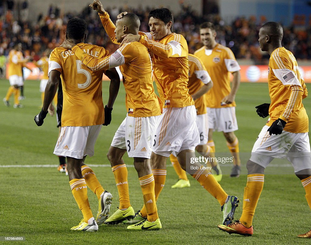 <a gi-track='captionPersonalityLinkClicked' href=/galleries/search?phrase=Ricardo+Clark&family=editorial&specificpeople=2196089 ng-click='$event.stopPropagation()'>Ricardo Clark</a> #13 of the Houston Dynamo points to Warren Creavalle #5 of the Houston Dynamo after his pass enabled him to score his second goal of the game as <a gi-track='captionPersonalityLinkClicked' href=/galleries/search?phrase=Brian+Ching&family=editorial&specificpeople=453218 ng-click='$event.stopPropagation()'>Brian Ching</a> #25 and Boniek Garcia #27 celebrate during second half action at BBVA Compass Stadium on March 2, 2013 in Houston, Texas. Houston won 2-0.