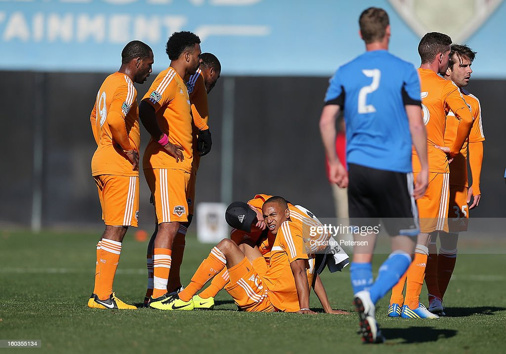 <a gi-track='captionPersonalityLinkClicked' href=/galleries/search?phrase=Ricardo+Clark&family=editorial&specificpeople=2196089 ng-click='$event.stopPropagation()'>Ricardo Clark</a> #13 of the Houston Dynamo reacts after a collision against the San Jose Earthquakes during The Desert Friendlies Presented By FC Tucson at Kino Sports Complex on January 29, 2013 in Tucson, Arizona. The Earthquakes defeated the Dynamo 2-0.