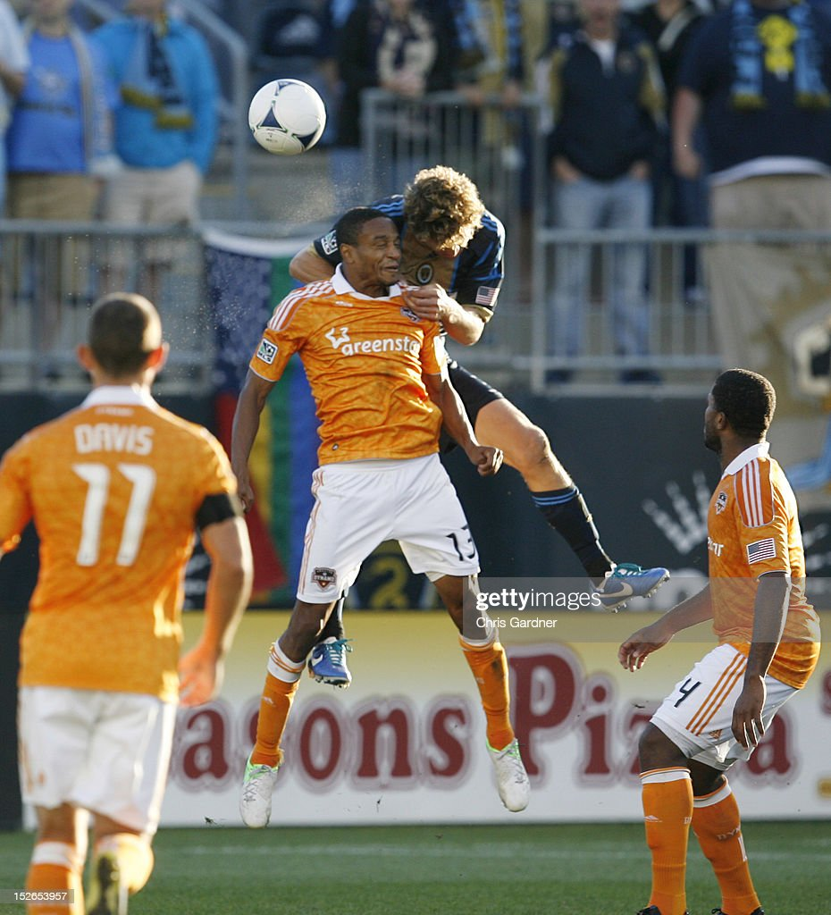 <a gi-track='captionPersonalityLinkClicked' href=/galleries/search?phrase=Ricardo+Clark&family=editorial&specificpeople=2196089 ng-click='$event.stopPropagation()'>Ricardo Clark</a> #13 of the Houston Dynamo wins a header as he is held by <a gi-track='captionPersonalityLinkClicked' href=/galleries/search?phrase=Chris+Albright&family=editorial&specificpeople=178253 ng-click='$event.stopPropagation()'>Chris Albright</a> #3 of the Philadelphia Union at PPL Park on September 23, 2012 in Chester, Pennsylvania.