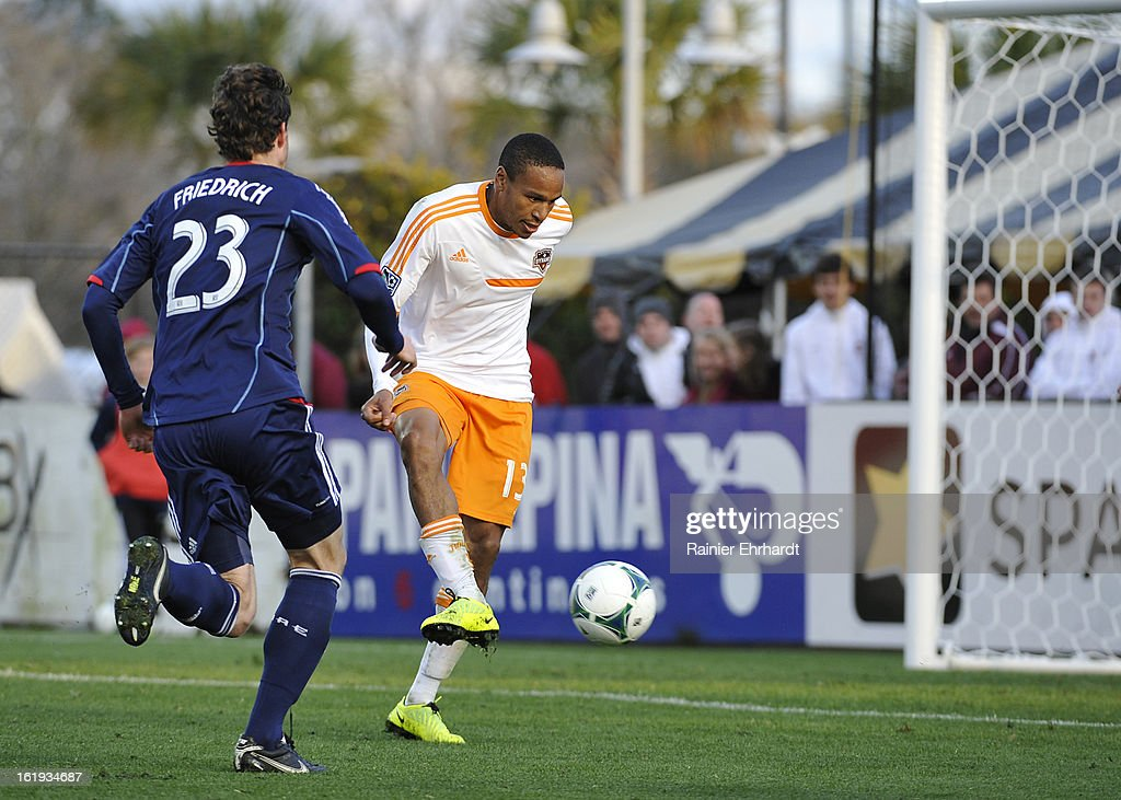 Ricardo Clarke #13 of the Houston Dynamo looks to score against the Chicago Fire during the first half of their game at Blackbaud Stadium on February 16, 2013 in Charleston, South Carolina.