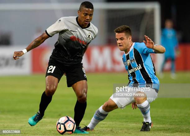Ricardo Clarke of Venezuela's Zamora vies for the ball with Ramiro of Brazil's Gremio during their Copa Libertadores 2017 football match held at the...