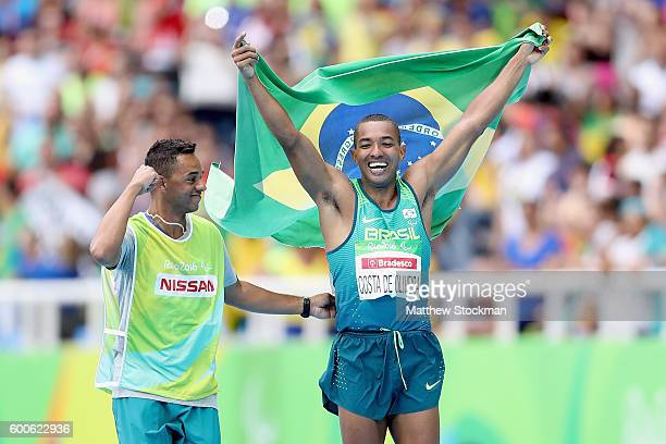 Ricardo Costa de Oliveira of Brazil celebrates winning the men's long jump T11 on day 1 of the Rio 2016 Paralympic Games at Olympic Stadium on...