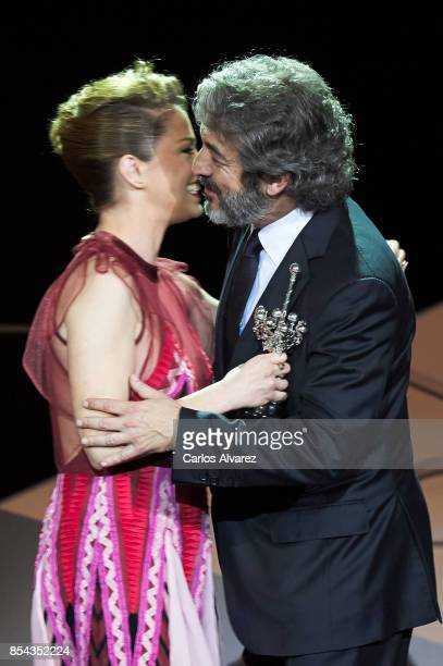 Ricardo Darin receives the Donostia Award from actress Dolores Fonzi at the Kursaal Palace during the 65th San Sebastian International Film Festival...