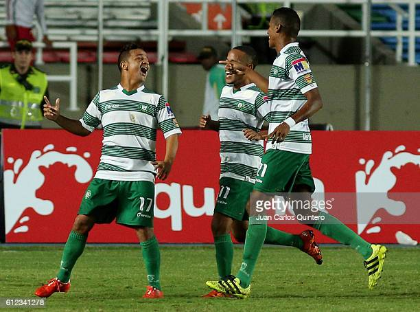 Ricardo Delgado of Valledupar celebrates with teammates after scoring the opening goal during a match between America de Cali and Valledupar as part...
